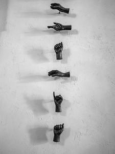 Sculptures of hands mounted on a wall, Havana, Cuba