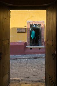 Boutique viewed through doorway, San Miguel de Allende, Guanajuato, Mexico
