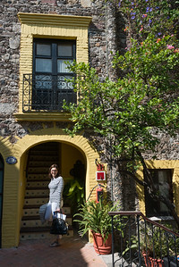 Woman standing at entrance of the Belmond Casa de Sierra Nevada hotel, San Miguel de Allende, Guanajuato, Mexico