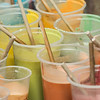 Close-up of paint filled plastic glasses, San Agustin, Dolores Hidalgo, Guanajuato, Mexico