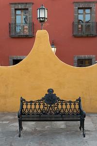 Bench on street along building, Zona Centro, San Miguel de Allende, Guanajuato, Mexico