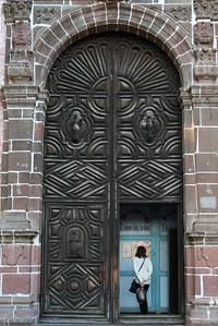 Woman standing in doorway, Zona Centro, San Miguel de Allende, Guanajuato, Mexico