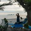 Woman looking at sea from a resort, Positano, Amalfi Coast, Salerno, Campania, Italy