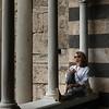 Woman sitting by columns at Amalfi Cathedral, Amalfi, Amalfi Coast, Salerno, Campania, Italy