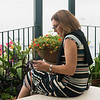 Woman using her mobile phone on balcony, Positano, Amalfi Coast, Salerno, Campania, Italy