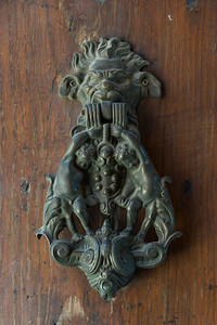 Close-up of an antique door knocker, Montepulciano, Siena, Tuscany, Italy