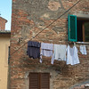 Low angle view of a clothesline hanging by wall, Montepulciano, Siena, Tuscany, Italy