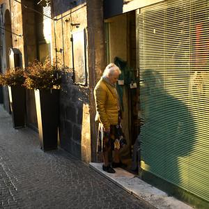 Woman entering in a shop, Orvieto, Terni Province, Umbria, Italy