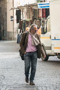 Man walking on a street, Orvieto, Terni Province, Umbria, Italy
