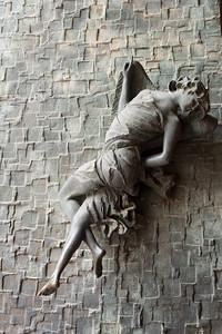 Statue on wall, Montepulciano, Siena, Tuscany, Italy