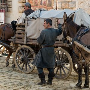 Men with horse drawn cart on street, Montepulciano, Siena, Tuscany, Italy