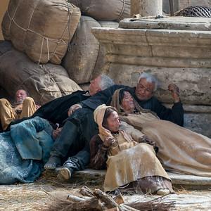 Beggars lying on street, Montepulciano, Siena, Tuscany, Italy