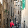 Senior couple walking on an alley, Orvieto, Terni Province, Umbria, Italy