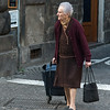 Senior woman pulling a shopping basket on a street, Orvieto, Terni Province, Umbria, Italy