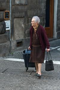 Senior woman pulling a shopping basket on a street, Orvieto, Terni Province, Umbria, Italy