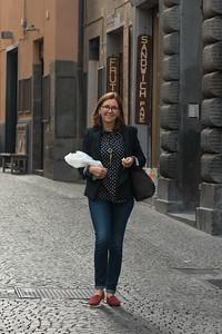 Happy woman walking on a street, Orvieto, Terni Province, Umbria, Italy