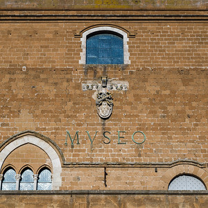 Low angle view of brick exterior of an historic building, Orvieto, Terni Province, Umbria, Italy