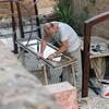 Carpenter preparing window in workshop, Orvieto, Terni Province, Umbria, Italy