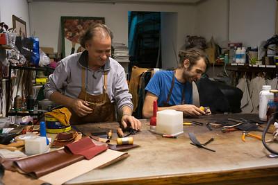 Men working in leather workshop, Via Garibaldi, Orvieto, Terni Province, Umbria, Italy