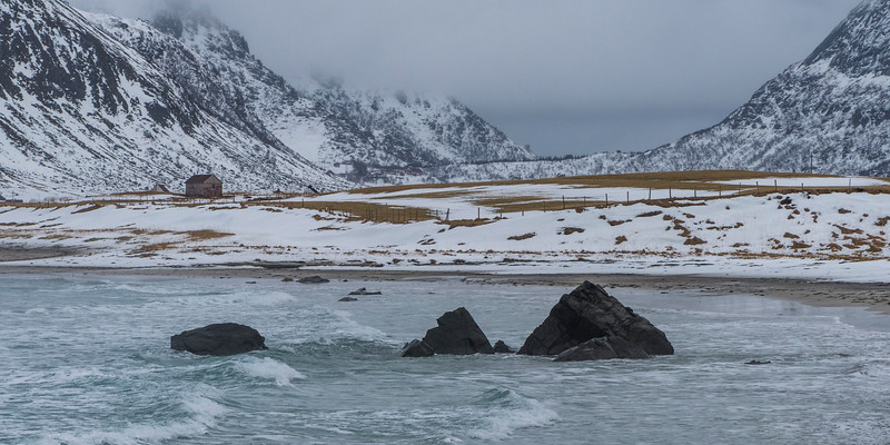 Sea with mountain range in the background, Lofoten, Nordland, Norway