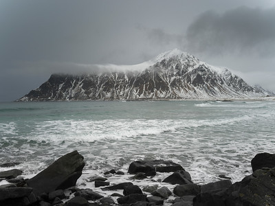 Rocks on the beach with mountain in the background, Lofoten, Nordland, Norway