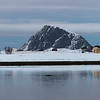 View of mountain at seaside against cloudy sky, Lofoten, Nordland, Norway