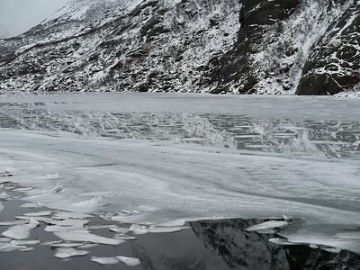 Reflection of mountain in frozen sea, Lofoten, Nordland, Norway