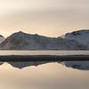 Reflection of mountain in water during sunset, Lofoten, Nordland, Norway