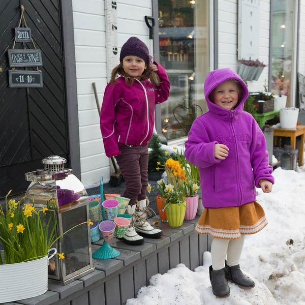 Two girls standing outside of a gift shop, Henningsvaer, Austvagoy, Lofoten, Nordland, Norway