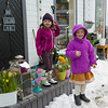 Two girls standing outside of a gift shop, Henningsvaer, Austvagoy, Lofoten, Nordland, Norway