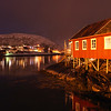 Fishing village lit up at night, Lofoten, Nordland, Norway