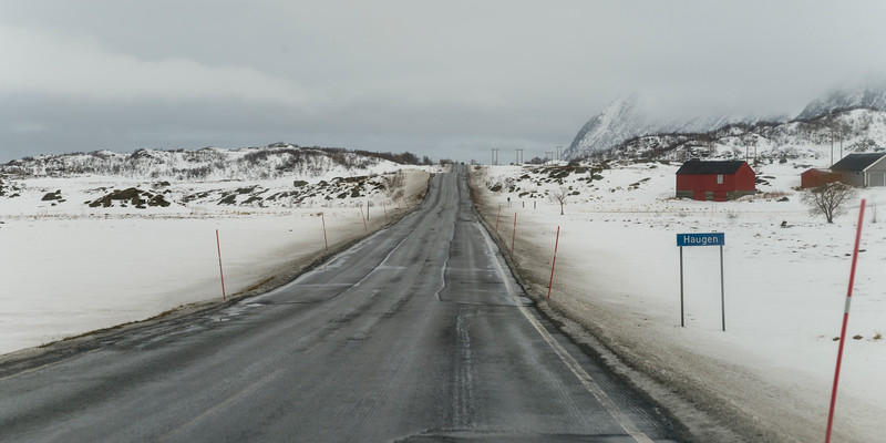 Road passing through snow covered landscape, Lofoten, Nordland, Norway