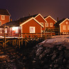 The typical red houses of fishermen lit up at night, Lofoten, Nordland, Norway