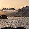 Rock formations in sea during sunset, Lofoten, Nordland, Norway