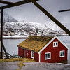 Village at waterfront with stilt hut at foreground, Lofoten, Nordland, Norway