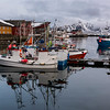 Boats at harbor with mountain in the background, Lofoten, Nordland, Norway