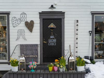 Potted plants on front doorstep, Henningsvaer, Austvagoy, Lofoten, Nordland, Norway
