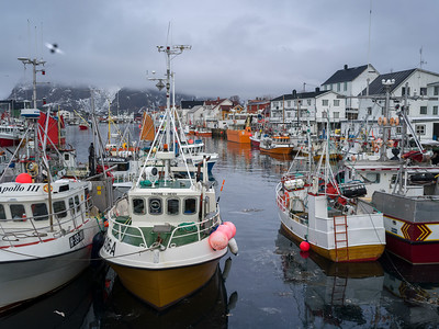 Boats at harbor with mountain in the background, Henningsvaer, Austvagoy, Lofoten, Nordland, Norway