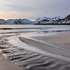Scenic view of shoreline and sea at sunset, Lofoten, Nordland, Norway