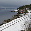 Snow covered railroad track at coast, Saltdal Fjord, Norway