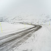 Empty road passing through snow covered mountain, Norrbotten County, Sweden