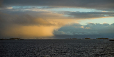 Scenic view of sea against cloudy sky, Nordland, Norway