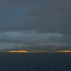 View of sea and mountain against cloudy sky, Nordland, Norway