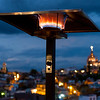 Illuminated lamp with buildings in background at dusk, Zona Centro, San Miguel de Allende, Guanajuato, Mexico