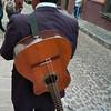 Rear view of a man with guitar on a street, San Miguel de Allende, Guanajuato, Mexico