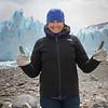 Smiling woman showing thumbs up on Perito Moreno Glacier, Los Glaciares National Park, Santa Cruz Province, Patagonia, Argentina