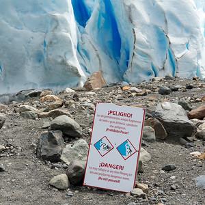 Danger signboard at Perito Moreno Glacier, Lake Argentino, Los Glaciares National Park, Santa Cruz Province, Patagonia, Argentina