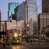 Tram on street amidst modern office buildings at Downtown Minneapolis, Hennepin County, Minnesota, USA