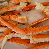 King Crab Legs on ice at a market stall, Pike Place Market, Seattle, Washington State, USA