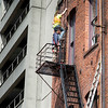 Maintenance workers working at a building, Pioneer Square, Seattle, Washington State, USA